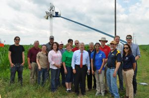 Iowa Governor Terry Branstad near an Iowa cornfield with a group of IFC researchers, landowners, and others.