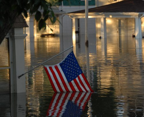 A flag is partially engulfed by floodwaters in Cedar Rapids.
