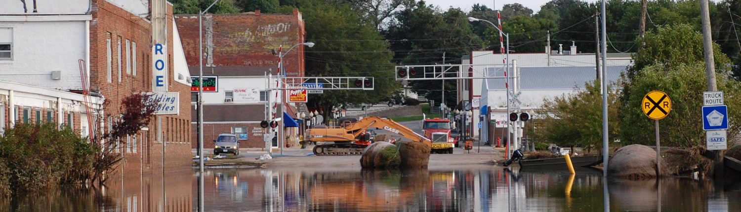 A flooded street scene in a small Iowa town.