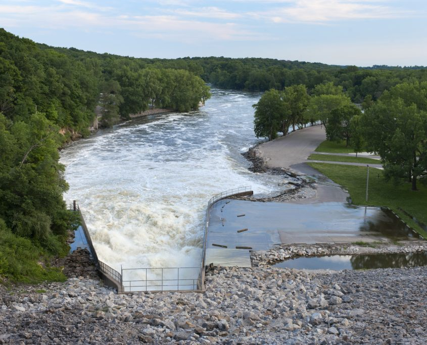 Floodwater gushes through the spillway at the Coralville Dam in 2014.