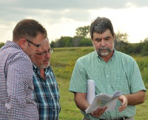 IFC researcher Allen Bradley talks with two colleagues in the field.