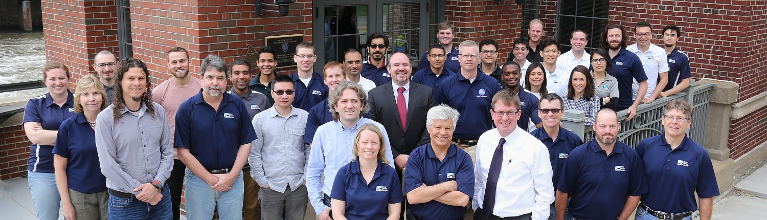 Group photo of the Iowa Flood Center faculty, students, and staff in front of the Stanley Hydraulics Lab