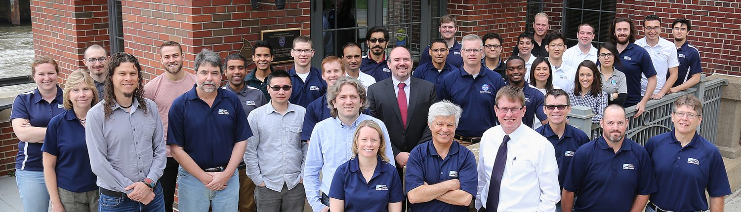 Group photo of IFC faculty, students, and staff outside the entrance of the Stanley Hydraulics Lab.