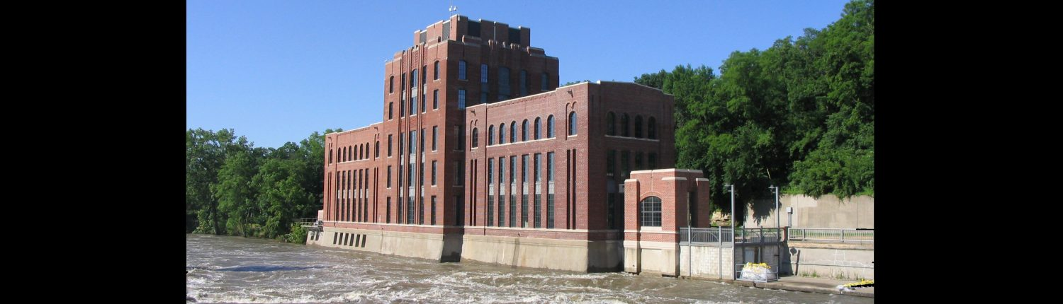 Floodwaters surge past the Stanley Hydraulics Lab on the banks of the Iowa River.