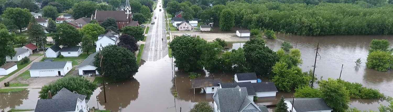 An aerial view of flooding in a small Iowa town. Photo by Kip Ladage.