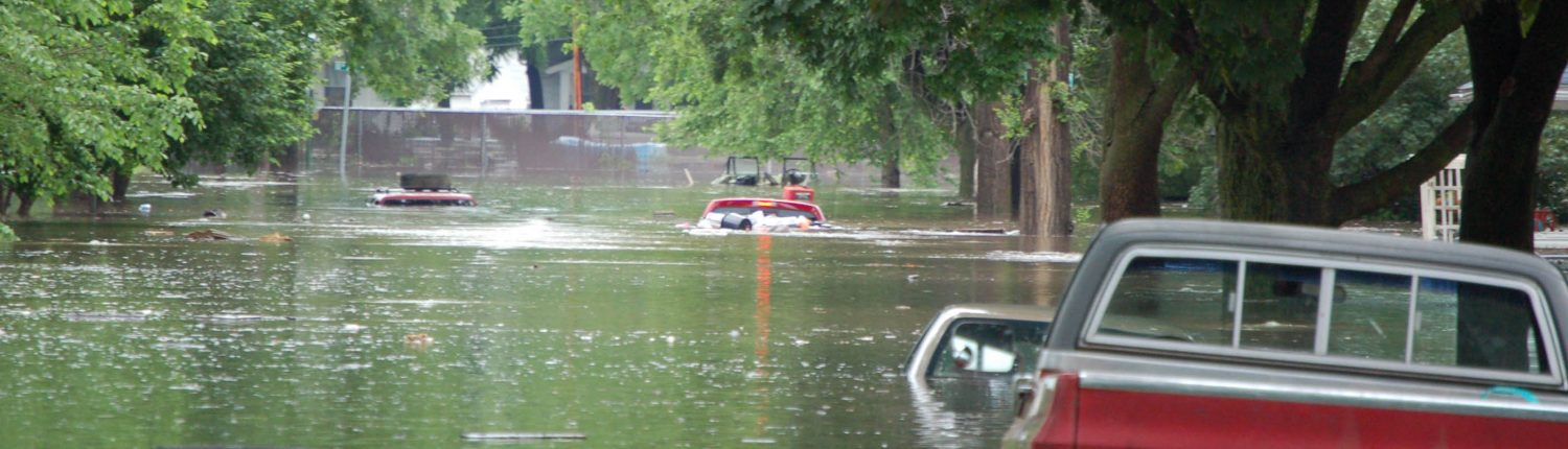 A Cedar Rapids street and several vehicles underwater during the 2008 flood.