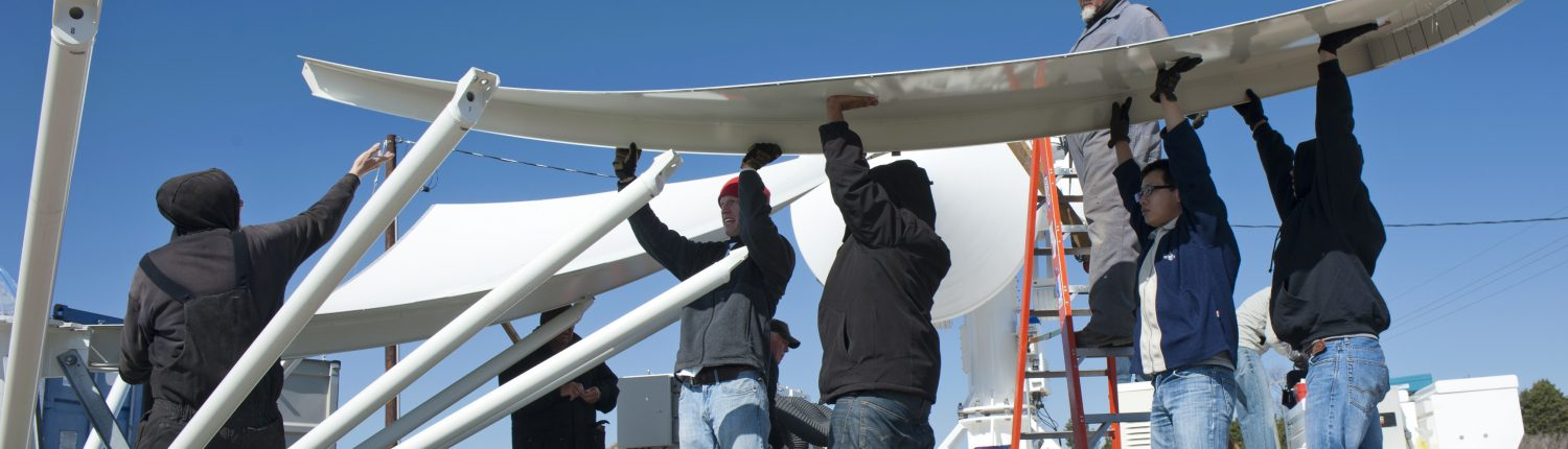 IFC students help set up a large radar as part of the IFloodS project.
