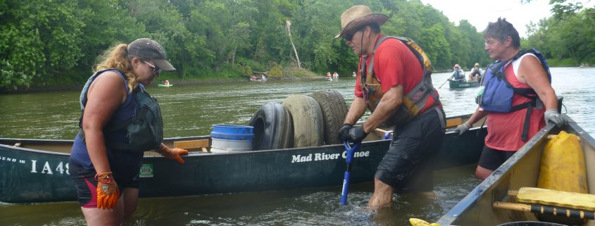 Volunteers remove trash from the Upper Cedar River during Project AWARE 2017.