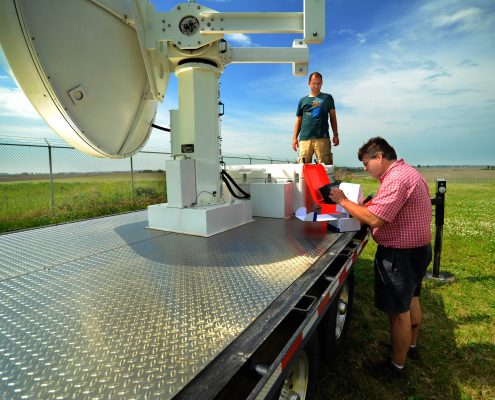 IFC researchers make adjustment to one of the mobile polarimetric X-band radar units.