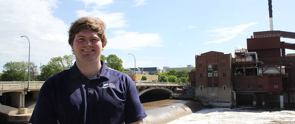 John stands in front of the Iowa River