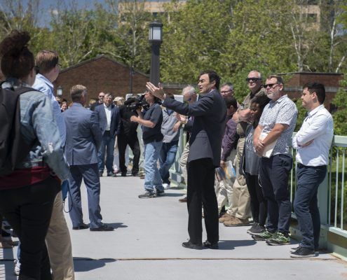 Lehnertz speaking to guests at a tour stop outdoors