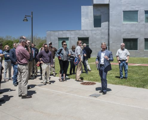 Guests stand in a group outside the Advanced Tech Lab