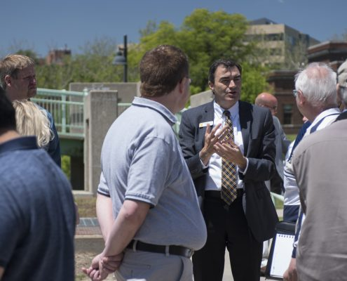 Lehnertz speaks to guests outside the IMU on the tour