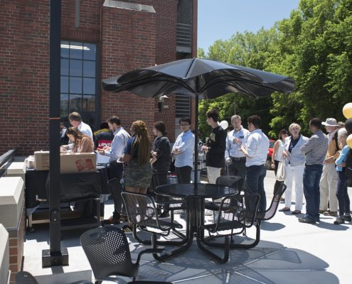 Guests eat lunch outside the Stanley Hydraulics Lab