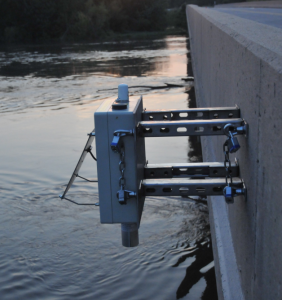 A stream sensor with a river in the background