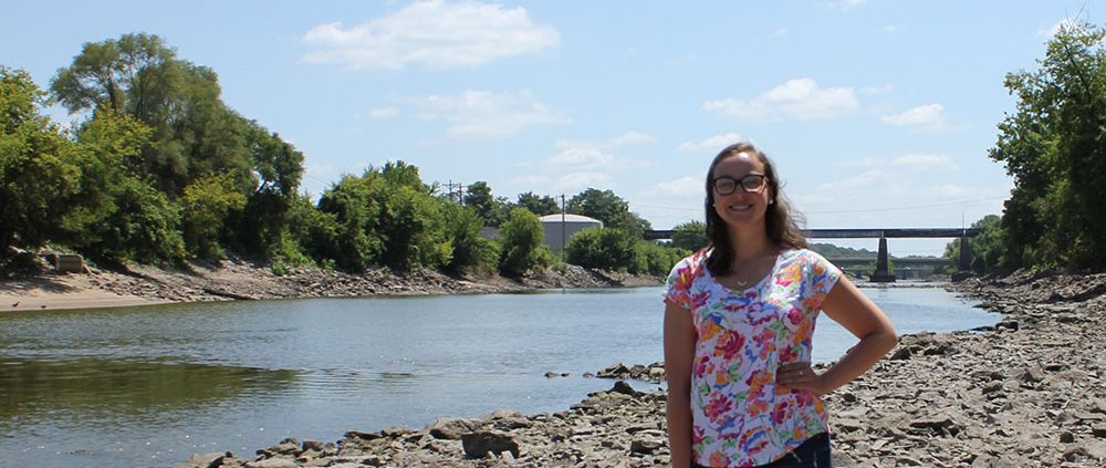 Matthews stands in front of the Iowa River